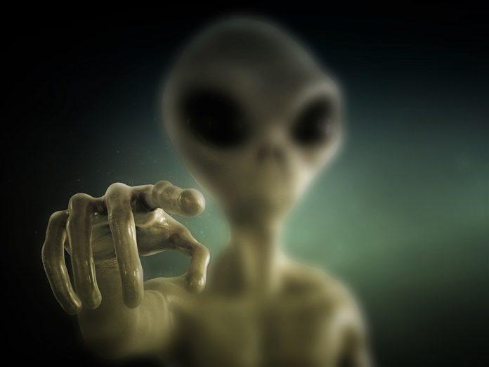 Alien pointing finger